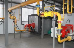 Two industrial gas boilers. Two industrial gas coppers in a modern boiler-house stock images