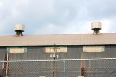 Two Industrial Metal Rooftop Vents With Cloudy Blue Sky View Stock Photos
