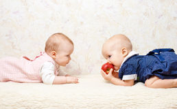 Two infants with apple Royalty Free Stock Photo