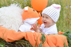 Two infants in funny suits Stock Photo