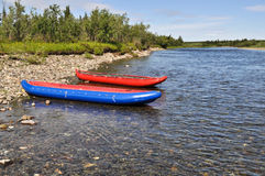 Two inflatable canoes on the shore of  North river. Stock Photography