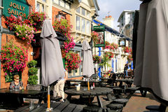 Two Inns, Poole, Dorset. Wonderful colorful flowers decorate two Inns on the quayside at Poole harbor, Dorset, England, UK royalty free stock photos