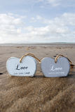 Two Inscribed Wooden Love Hearts In The Sand Royalty Free Stock Photo