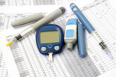 Two of insulin and meter. Two of insulin and blood glucose meter Royalty Free Stock Images