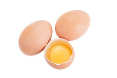 Two integer and one broken egg isolated on white background Stock Photography