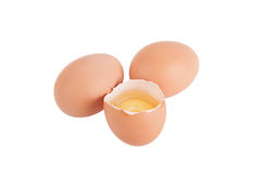 Two integer and one broken egg isolated on white background Royalty Free Stock Photography