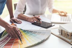Two interior design or graphic designer at work on project of ar Royalty Free Stock Photo