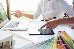 Two interior design or graphic designer at work on project of ar Royalty Free Stock Images