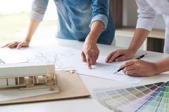Two interior design or graphic designer at work on project of ar Royalty Free Stock Image