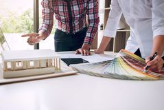 Two interior design or graphic designer at work on project of ar stock image