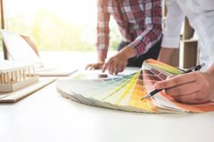 Two interior design or graphic designer at work on project of ar stock photos