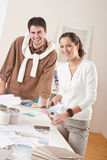 Two interior designer working with color swatch. Two interior designer working at office with color swatch and can of paint stock photo