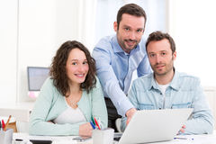 Two interns working together assisted by their course supervisor Stock Images