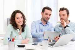 Two interns working together assisted by their course supervisor Royalty Free Stock Images