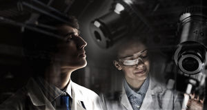 Two interns working together . Mixed media Stock Images