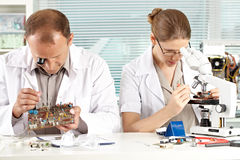 Two inventors in maintenance shop Royalty Free Stock Photos