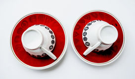 Two inverted cups and two saucers.  Stock Photo