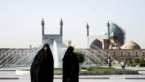Two Iranian women on Imam Square,Isfahan Iran stock photos