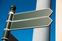 Two irish signpost. S with blue sky and copyspace Stock Images