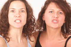 Two iritated young women portrait Stock Photography