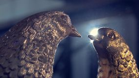 Two iron dove. Two doves forged from iron in the background shines the spotlight.  stock video footage