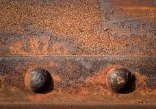 Two iron rivets Royalty Free Stock Photography