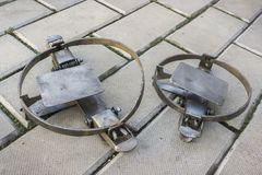 Two iron traps on the stone floor royalty free stock photo