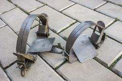 Two iron traps on stone floor stock images