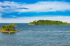 Two islands in front of the port of Puerto Limon Stock Images