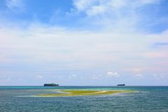 Two islands on the horizon. In the Pacific Ocean. View from the island of Siargao in the Philippines Royalty Free Stock Images