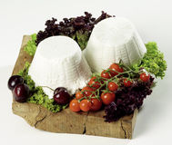 Two isolated. Isolated ricotta cheese on cutting board Royalty Free Stock Photo