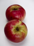 Two isolated akane apples Royalty Free Stock Photos