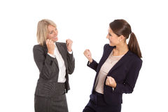 Two isolated businesswoman proud of her success. Stock Images