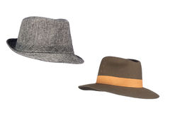 Fedora hats on white. Two isolated fedora sunhats for use as retro revival clothing objects or any other headwear inferences royalty free stock photo