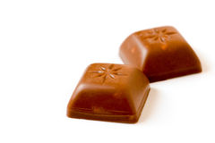 Two isolated pieces of chocolate Stock Photography