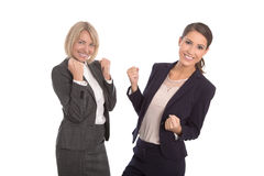 Two isolated successful woman working in a team. Isolated portrait with two businesswoman. royalty free stock photos