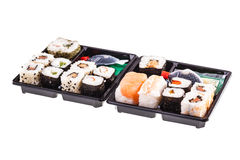 Two isolated Sushi boxes Royalty Free Stock Photos