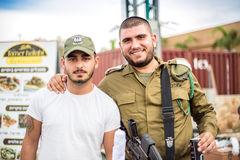 Two Israeli soldiers posing to the photo. Mount Carmel, Israel - October 28, 2015: Two Israeli soldiers posing to the photo on Mount Carmel Royalty Free Stock Images