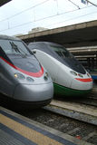 Two Italian express trains. Two Italian Eurostar express trains at Termini, the main railway station in Rome, Italy Stock Photos