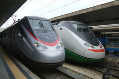 Two Italian express trains. Two Italian Eurostar express trains at Termini, the main railway station in Rome, Italy Stock Photography