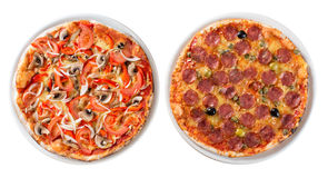 Two italian pizzas isolated top view royalty free stock photography