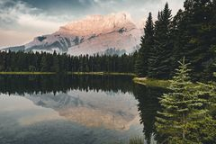 Two Jack Lake with mountain reflections along the Two Jack Lake. In Banff National Park, Alberta, Canada Royalty Free Stock Photography