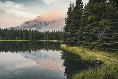 Two Jack Lake with mountain reflections along the Two Jack Lake. In Banff National Park, Alberta, Canada Stock Image