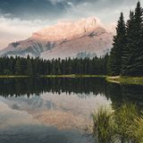 Two Jack Lake with mountain reflections along the Two Jack Lake. In Banff National Park, Alberta, Canada Royalty Free Stock Images