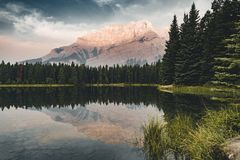 Two Jack Lake with mountain reflections along the Two Jack Lake. In Banff National Park, Alberta, Canada Stock Images