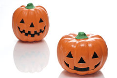 Two jack lanterns. The ornament of the Japanese pumpkin photoed in the white back Royalty Free Stock Photography