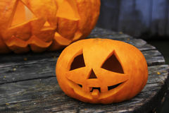 Two jack-o'-lantern on an old wooden table. Stock Images
