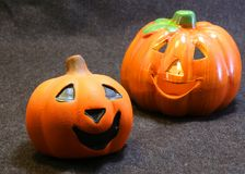 Two jack o lantern symbols of Halloween Stock Photos