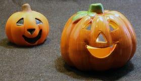 Two jack o lantern symbols of Halloween. Two Orange jack o lantern symbols of Halloween Royalty Free Stock Image