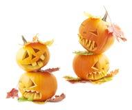 Two Jack-o'-lanterns pumpkin heads stock photos